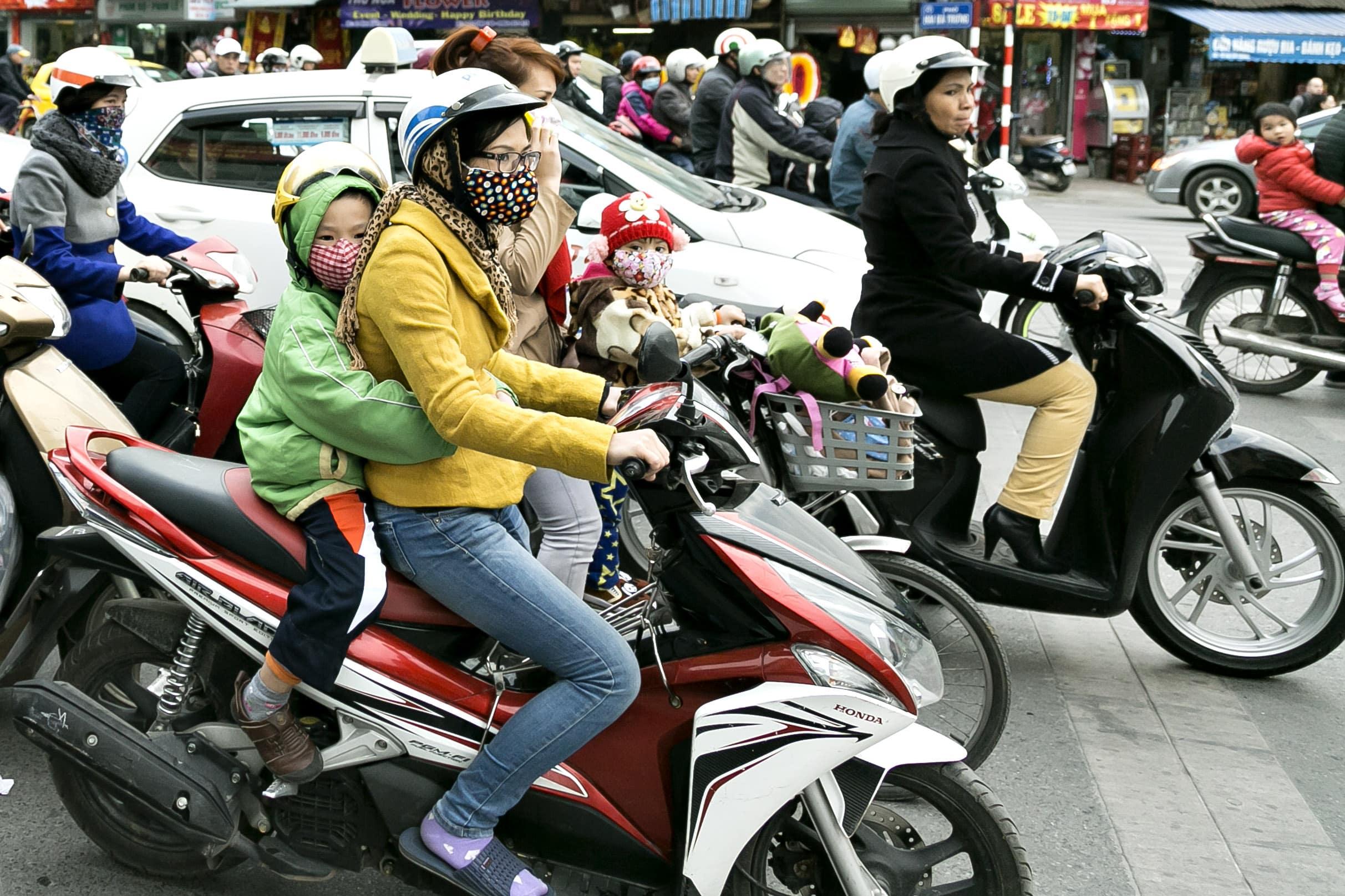 scooter, motorcykler transport vietnam.Genrebilleder. Erhvervsbilleder, erhvervsfoto, hjemmeside, markedsføring,